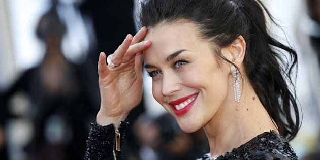 Australian model Megan Gale poses as she arrives for the screening of the film 'Youth' at the 68th Cannes Film Festival in Cannes, southeastern France, on May 20, 2015.      AFP PHOTO / VALERY HACHE        (Photo credit should read VALERY HACHE/AFP/Getty Images)