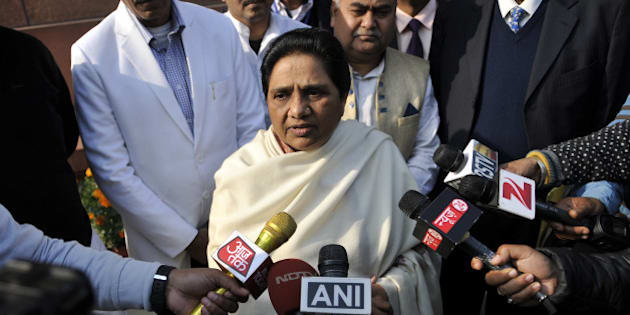 NEW DELHI, INDIA - DECEMBER 21: Mayawati Supremo BSP talking to media personnel after Rajya Sabha passes SC/ST Bill, supplementary demands without debate during the Winter Session of the Parliament at Parliament House on December 21, 2015 in New Delhi, India. As pressure mounted on it for early passage of the Juvenile Justice Bill, the government today listed the crucial legislation in Rajya Sabha for passage tomorrow and blamed Congress for blocking it in the past due to its obstructionist politics even when it was listed on 15 occasions. (Photo by Vipin Kumar/Hindustan Times via Getty Images)