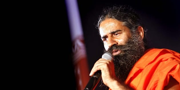 NEW DELHI, INDIA - OCTOBER 9: Yoga Guru Baba Ramdev addresses during a press conference on October 9, 2015 in New Delhi, India. Future Group tied up with Yoga Guru Baba Ramdev's Patanjali Ayurved to sell the latter's products. (Photo by Arun Sharma/Hindustan Times via Getty Images)