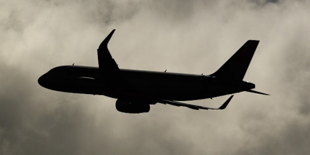 An Airbus SAS A321 aircraft operated by Jetstar Airways, the budget arm of Qantas Airways Ltd., is silhouetted as it takes off from Sydney Airport in Sydney, Australia, on Monday, Feb. 22, 2016. Qantas Airways is scheduled to announce half-year earnings on Feb. 23. Photographer: Brendon Thorne/Bloomberg via Getty Images