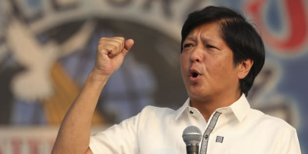"ADDS MRCOS JR. IS RUNNING FOR VICE-PRESIDENT - Sen. Ferdinand ""Bongbong"" Marcos Jr., the son of the late Philippine strongman Ferdinand Marcos, gestures as he talks during a gathering of a religious group in suburban Quezon city, north of Manila, Philippines Sunday, Feb. 14, 2016. Marcos Jr. is running for vice-president along with Sen. Miriam Defensor-Santiago, a tough-talking former trial court judge, one of five presidential candidates in the coming elections this May. (AP Photo/Aaron Favila)"