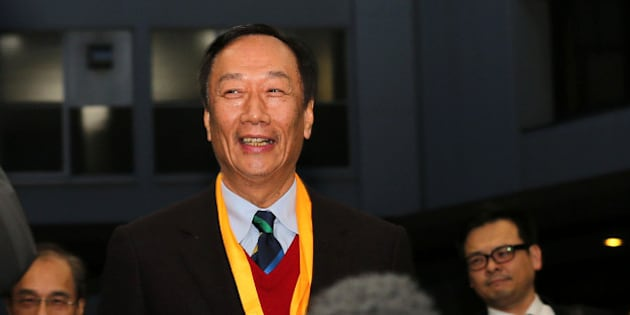 Terry Gou, chairman of Foxconn Technology Group, arrives at a podium before he speaks to media at the Sharp Corp. headquarters in Osaka, Japan on Friday, Feb 5, 2016. Gou took a step forward in the hotly contested battle for control of Japans Sharp Corp., winning an agreement to become the preferred negotiating partner for a bailout of the struggling consumer electronics maker. Photographer: Buddhika Weerasinghe/Bloomberg via Getty Images