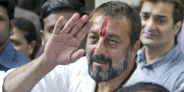 Bollywood actor Sanjay Dutt waves as he arrives at his residence in Mumbai, India, Thursday, Nov. 29, 2007. Bollywood star Sanjay Dutt was released from prison Thursday after India's top court granted him bail pending an appeal against his conviction for possessing illegal weapons, an official said. (AP Photo/Gautam Singh)