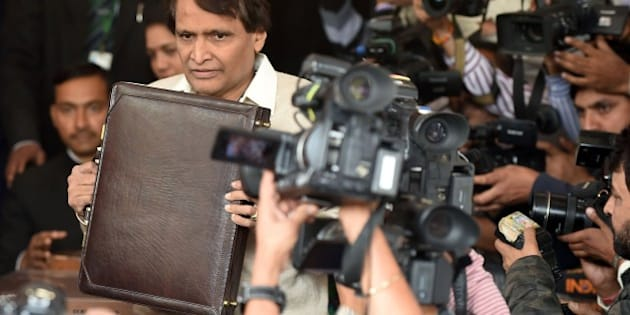 Indian Railways Minister Suresh Prabhu poses for media representatives as he arrives at Parliament House to table the Railway Budget in New Delhi on February 25, 2016.  AFP PHOTO / Prakash SINGH / AFP / PRAKASH SINGH        (Photo credit should read PRAKASH SINGH/AFP/Getty Images)
