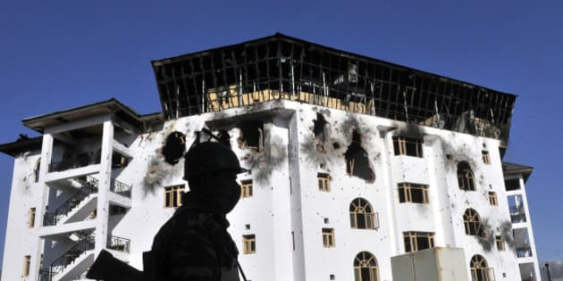 SRINAGAR, INDIA - FEBRUARY 23: The damaged exterior of the Entrepreneurship Development Institute building in which militants were holed up during a gunfight on February 23, 2016 in Sempora, Pampore on the outskirts of Srinagar, India. Three militants barged into the institute building on Saturday soon after attacking a convoy of security forces, leaving three CRPF jawans dead and eight injured. One civilian, Abdul Gani Mir died after sustaining a bullet injury later. (Photo by Waseem Andrabi/Hindustan Times via Getty Images)