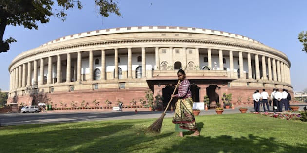 NEW DELHI, INDIA - FEBRUARY 23: A Lady cleans compound of Parliament House on the first day of the Budget Session on February 23, 2016 in New Delhi, India. (Photo by Arvind Yadav/Hindustan Times via Getty Images)