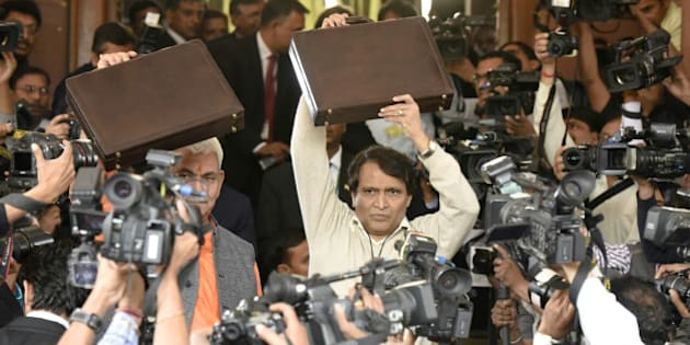 NEW DELHI, INDIA - FEBRUARY 25: Indian Railway Minister Suresh Prabhu arrives at Parliament for presenting the Railway Budget along with MOS Manoj Sinha, on February 25, 2016 in New Delhi, India. Talking to the reporters on this occasion, Prabhu said that the Rail Budget will cater to the needs of all satisfactorily as a lot of effort has gone into its preparation. (Photo by Mohd Zakir/Hindustan Times via Getty Images)