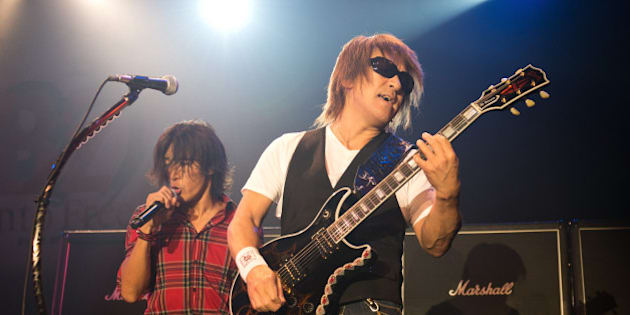 NEW YORK, NY - SEPTEMBER 30: Koshi Inaba and Tak Matsumoto (R) of B'z perform on stage at Best Buy on September 30, 2012 in New York, United States. (Photo by Daniel Boczarski/Redferns via Getty Images)