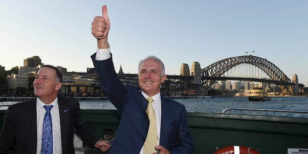 Australian Prime Minister Malcolm Turnbull, right, and New Zealand Prime Minister John Key travel on a ferry on Sydney Harbour with a backdrop of the Sydney Harbour Bridge in Sydney, Friday, Feb. 19, 2016. Turnbull and Key are traveling to Turnbull's home. (AP Photo/Dean Lewins, Pool)