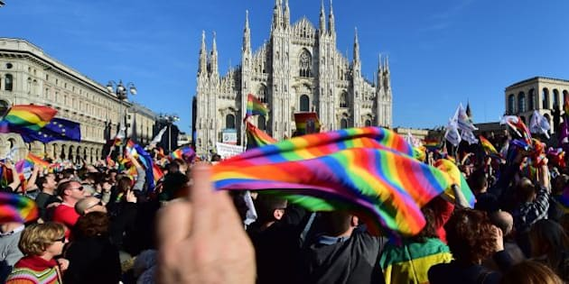 Supporters of the bill 'Cirinna' to be voted at the Italian Senate allowing gay civil unions, demonstrate on February 21, 2016 at Piazza Duomo in Milan.  Italy's Senate suspended last week a debate over legislation allowing gay civil unions after the populist Five Star Movement (M5S) scuppered a move to push the historic bill through the upper house unscathed. / AFP / GIUSEPPE CACACE        (Photo credit should read GIUSEPPE CACACE/AFP/Getty Images)