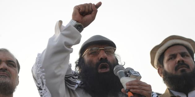 Syed Salahuddin, chairman of the 16-party United Jihad Council, who is also supreme commander of the hardline Hizbul Mujahedin group, addresses the demonstrators during a protest to mark Kashmir Solidarity day in Karachi on February 5, 2015.  Pakistan observed Kashmir Solidarity Day on February 5 to denounce Indian rule in the disputed Himalayan region claimed in whole by both countries.  AFP PHOTO / Rizwan TABASSUM        (Photo credit should read RIZWAN TABASSUM/AFP/Getty Images)