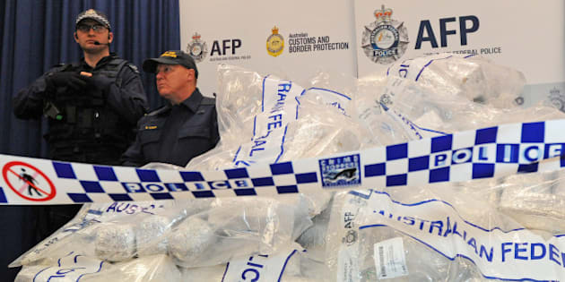 Australian Federal Police (AFP) guard 525 million USD worth of crystal methamphetamine ('ice') and heroin after smashing a Hong Kong-based international drugs syndicate in Sydney on July 31, 2012. It was the largest haul of ice (306 kilograms) in Australian history and the third-biggest heroin bust (252 kilograms) and was the culmination of an 11-month operation following a tip-off from the US Drug Enforcement Administration.  AFP PHOTO / Torsten BLACKWOOD        (Photo credit should read TORSTEN BLACKWOOD/AFP/GettyImages)