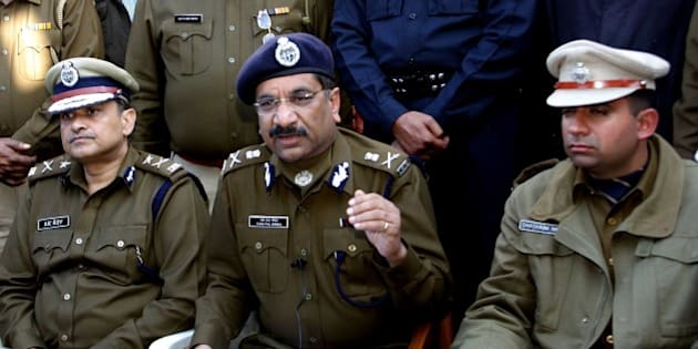 ROHTAK, INDIA - FEBRUARY 9: Haryana Director General Police Mr. Y.S.Singhal addressing the media persons regarding the arrest of eight accused from Gaddi Kheri Village in connection with the brutal rape and murder of a 28-year old Nepalese woman, on February 9, 2015 in Rohtak, India. Y.P. Singhal said that one of the arrested persons is from Nepal. The woman had been brutally assaulted as the post-mortem report mentions several injuries on her private parts. Stones and blades were found in her stomach. (Photo by Manoj Dhaka/Hindustan Times via Getty Images)