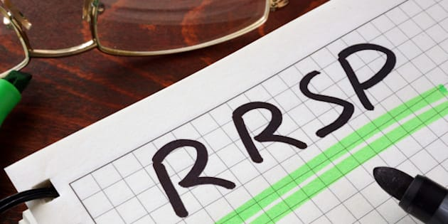 Notebook with RRSP  sign on a table. Business concept.