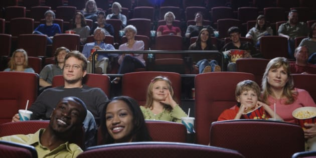 People in Theater Watching Movie