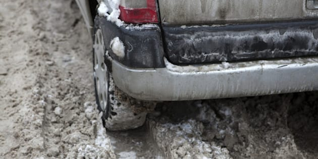 Car under the snow. Winter trouble