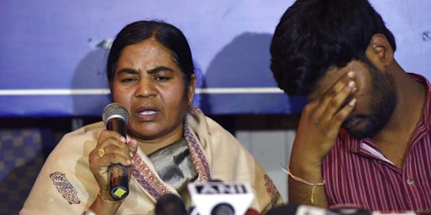 NEW DELHI, INDIA - FEBRUARY 26: Mother Radhika of Dalit research scholar Rohith Vemula with Prasanth Dontha, a student expelled from Hyderabad University at a press conference on HRD Minister Smriti Irani speech in Parliament of Rohith Vemula suicide on February 26, 2016 in New Delhi, India. Rohith Vemulas family and friends today attacked Union Education Minister Smriti Irani, calling her speech in Parliament on the research scholar's suicide a set of absolute lies. (Photo by Virendra Singh Gosain/Hindustan Times via Getty Images)