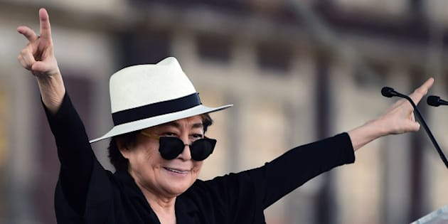 Japanese musician and artist Yoko Ono, widow of John Lennon, waves before an event of the Secretary of Cultura at Zocalo Square in Mexico City, on February 2, 2016. Yoko Ono is in Mexico for diverse activities. AFP PHOTO/ALFREDO ESTRELLA / AFP / ALFREDO ESTRELLA        (Photo credit should read ALFREDO ESTRELLA/AFP/Getty Images)