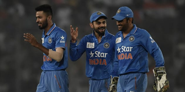 Indian cricketers  Hardik Pandya (L) and Virat Kohli (C) and captain Mahendra Singh Dhoni react after the dismissal of the Pakistan cricketer Mohammad Sami during the match between India and Pakistan at the Asia Cup T20 cricket tournament at the Sher-e-Bangla National Cricket Stadium in Dhaka on February 27, 2016. AFP PHOTO/Munir uz ZAMAN / AFP / MUNIR UZ ZAMAN        (Photo credit should read MUNIR UZ ZAMAN/AFP/Getty Images)