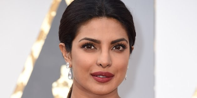 Priyanka Chopra arrives on the red carpet for the 88th Oscars on February 28, 2016 in Hollywood, California. AFP PHOTO / VALERIE MACON / AFP / VALERIE MACON        (Photo credit should read VALERIE MACON/AFP/Getty Images)