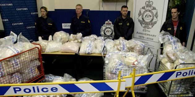(AUSTRALIA & NEW ZEALAND OUT) Officials with the biggest ever MDMA seizure by Australian Customs Service and the Australian Federal Police, 15 November 2004. SMH Picture by PAUL MILLER. (Photo by Fairfax Media/Fairfax Media via Getty Images)