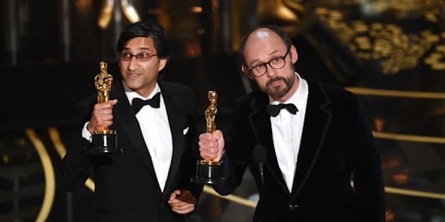 HOLLYWOOD, CA - FEBRUARY 28:  Filmmakers Asif Kapadia (L) and James Gay-Rees accept the Best Documentary Feature award for 'Amy' onstage during the 88th Annual Academy Awards at the Dolby Theatre on February 28, 2016 in Hollywood, California.  (Photo by Kevin Winter/Getty Images)