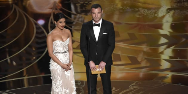 Priyanka Chopra, left, and Liev Schreiber present the award for best film editing at the Oscars on Sunday, Feb. 28, 2016, at the Dolby Theatre in Los Angeles. (Photo by Chris Pizzello/Invision/AP)
