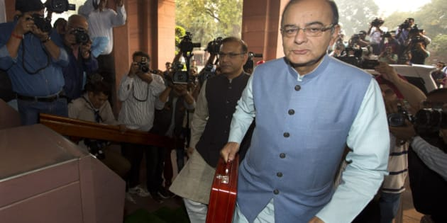Indian Finance Minister Arun Jaitley arrives at parliament house to present federal budget 2016-17, in New Delhi, India, Monday, Feb. 29, 2016. It was Jaitley's second full budget since Prime Minister Narendra Modi won a huge majority in national election in 2014, on the back of promises to turn around the economy and boost job creation. There have been few sweeping reforms in the past two years that the government has been promising. (AP Photo/Manish Swarup)