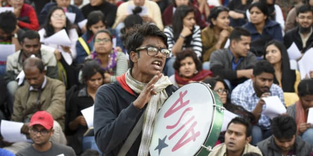 NEW DELHI, INDIA - FEBRUARY 22: The JNU students having a meeting during their protest against the sedition charges leveled against their fellow students at JNU on February 22, 2016 in New Delhi, India. Five JNU students Umar Khalid, Anant Prakash Narayan, Ashutosh Kumar, Rama Naga and Anirban Bhattacharya, accused of sedition, re-appeared on the campus on Sunday, having spent 10 days in hiding. The five students are accused of allegedly planning an event on February 9 against the hanging of Parliament attack convict Afzal Guru, where anti-national slogans were allegedly shouted.  Police waited outside the university gates on Monday but did not enter the campus in the absence of mandatory permission from the vice-chancellor. (Photo by Vipin Kumar/Hindustan Times via Getty Images)