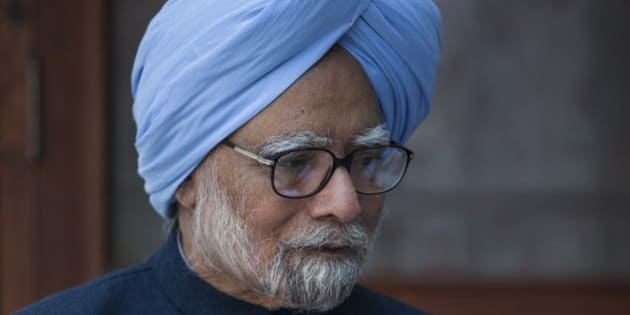 "Former Indian prime minister Manmohan Singh, sits with the newly elected office bearers of ""National Students' Union of India"" (NSUI), who called on him at his residence in New Delhi, India, Tuesday, March 17, 2015. A special Indian court last week summoned Singh, accusing him of criminal conspiracy and breach of trust for his alleged role in a multibillion dollar scandal over the sale of coal fields. (AP Photo/Tsering Topgyal)"