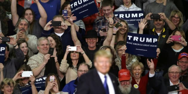 Supporters reacts as Republican presidential candidate Donald Trump speaks during a campaign rally at Clinton Middle School, Saturday, Jan. 30, 2016, in Clinton, Iowa. (AP Photo/Charlie Neibergall)