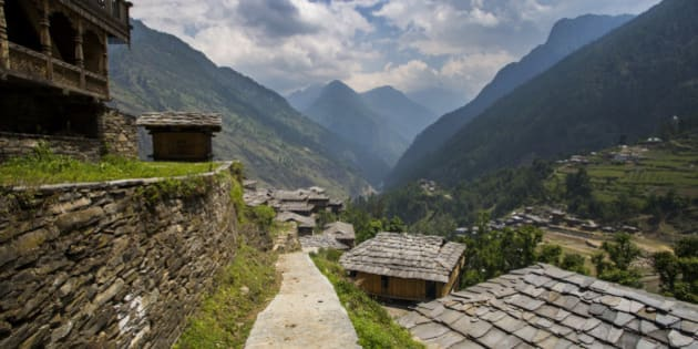 Uniquely roofed slate tiled roofs in the village of Kunwar along the border of Govind National Park in the Himalayan foothills.