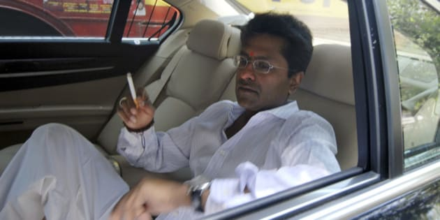 Indian Premier League chief Lalit Modi smokes a cigarette inside his car on his way to meet Mukesh Ambani, a top industrialist and owner of the IPL team Mumbai Indians, in Mumbai, India, Thursday, April 22, 2010. Income tax officials questioned beleaguered Modi over corruption allegations surrounding a new franchise for a second successive day Thursday, while tax sleuths searched offices of various team franchises that feature in the immensely successful Twenty20 league. (AP Photo)