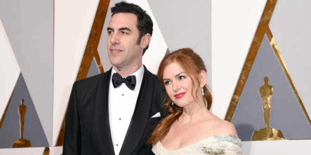 Sacha Baron Cohen, left, and Isla Fisher arrive at the Oscars on Sunday, Feb. 28, 2016, at the Dolby Theatre in Los Angeles. (Photo by Dan Steinberg/Invision/AP)