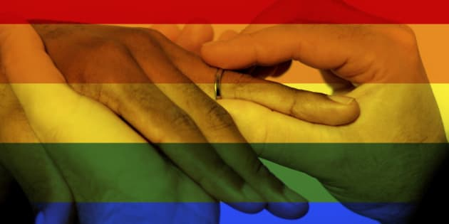 Photo composite of Iconic image style used in social media to celebrate legalization of same-sex marriage.  This image style, of a profile picture with an overlaid rainbow flag went viral in social media to celebrate the court decision to legalize gay marriage.