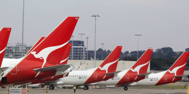 The tails of Qantas planes are lined up at Sydney Airport in Sydney, Sunday, Oct. 30, 2011. Qantas Airways grounded all of its aircraft around the world indefinitely Saturday due to ongoing strikes by its workers. (AP Photo/Rick Rycroft)