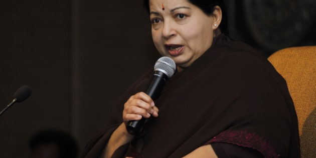 FILE - In this June 14, 2011 file photo, former chief minister of Tamil Nadu state Jayaram Jayalalitha addresses a press conference in New Delhi, India. An appeals court in southern India acquitted powerful regional politician Jayalalitha of corruption charges Monday, clearing the way for her to return to public office. Jayalalitha was forced last year to step down as the highest elected official in the southern state of Tamil Nadu, after a Bangalore court in September convicted her of possessing wealth disproportionate to her income and sentenced her to four years in prison. (AP Photo/Saurabh Das, File)