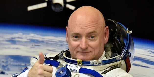 US astronaut Scott Kelly gestures as his space suit is tested at the Russian-leased Baikonur cosmodrome, prior to blasting off to the International Space Station (ISS), late on March 27, 2015. The international crew of US astronaut Scott Kelly and Russian cosmonauts Gennady Padalka and Mikhail Kornienko is scheduled to blast off to the ISS from Baikonur early on March 28. AFP PHOTO / KIRILL KUDRYAVTSEV        (Photo credit should read KIRILL KUDRYAVTSEV/AFP/Getty Images)