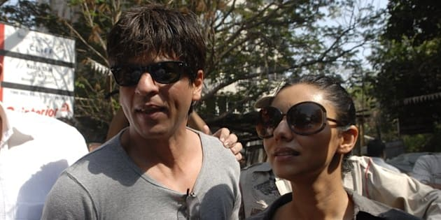 MUMBAI, INDIA - APRIL 30: Shah Rukh Khan with wife Gauri talks to media after casting their vote on April 30, 2009 in Mumbai, India. India is the world's largest democracy and voting is scheduled to take place in a series of five rounds over a period of five weeks. (Photo by Mandar Deodhar/India Today Group/Getty Images)