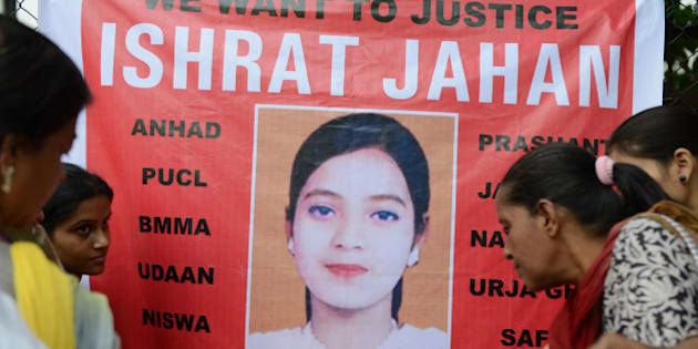 Supporters hold candles in front of a banner bearing the portrait of Ishrat Jahan during a protest in Ahmedabad on July 6, 2013. The protest was organised to demand justice for Ishrat Jahan, who was killed along with three others by the Gujarat police in a fake encounter in June 2004, and according to the Indian Central Beurau of Investigation (CBI) was not a terrorist. AFP PHOTO / Sam PANTHAKY        (Photo credit should read SAM PANTHAKY/AFP/Getty Images)