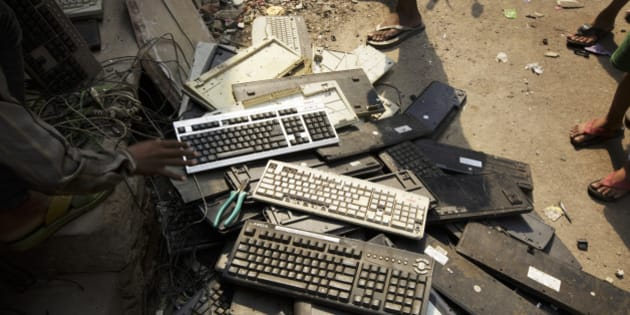 Used computer keyboards sit in a pile on the street in New Delhi, India, on Thursday, June 18, 2015. The rupee climbed 0.8 percent in the five days ended June 19, its best week in three months, while the 2024 debt completed its biggest weekly advance since it was first issued in July. Photographer: Kuni Takahashi/Bloomberg via Getty Images