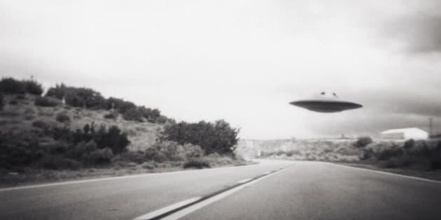 Flying saucer above highway