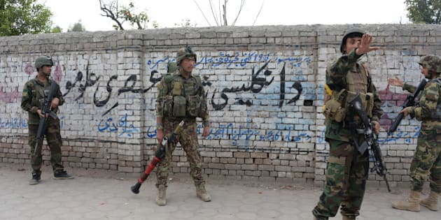 Afghan National Army (ANA) soldiers arrive at the site of an attack in front of the Indian consulate in Jalalabad on March 2, 2016. Explosions and gunfire echoed on March 2 as militants attacked the Indian consulate in Jalalabad in the latest assault to rattle the eastern Afghan city. AFP PHOTO / Noorullah SHIRZADA / AFP / Noorullah Shirzada        (Photo credit should read NOORULLAH SHIRZADA/AFP/Getty Images)