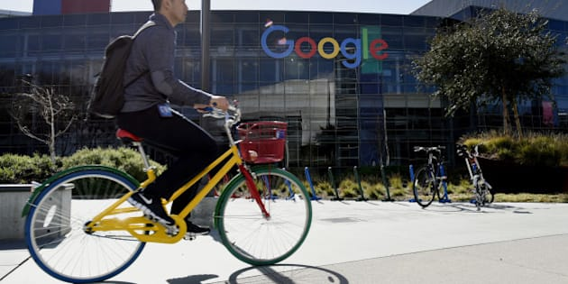 A cyclist rides past Google Inc. offices inside the Googleplex headquarters in Mountain View, California, U.S., on Thursday, Feb. 18, 2016. Google, part of Alphabet Inc., plans on tapping into existing fiber networks in San Francisco to deliver ultra-fast internet access across the city. Photographer: Michael Short/Bloomberg via Getty Images