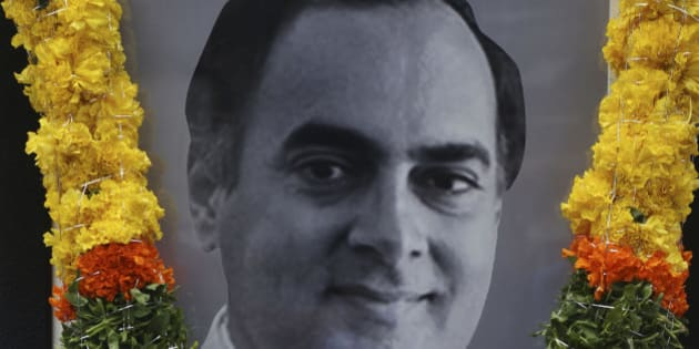 India's main opposition Congress leader pays tribute to a portrait of former Indian Prime Minister Rajiv Gandhi on his birth anniversary in Hyderabad, India, Thursday, Aug. 20, 2015. Rajiv Gandhi was killed in a suicide bomb attack on May 21, 1991 in Tamil Nadu state during an election campaign. (AP Photo/Mahesh Kumar A.)