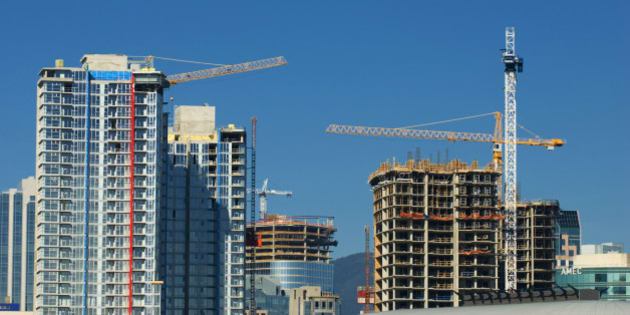 Cranes and towering skyscrapers shape the Vancouver Skyline, Vancouver, British Columbia, Canada.