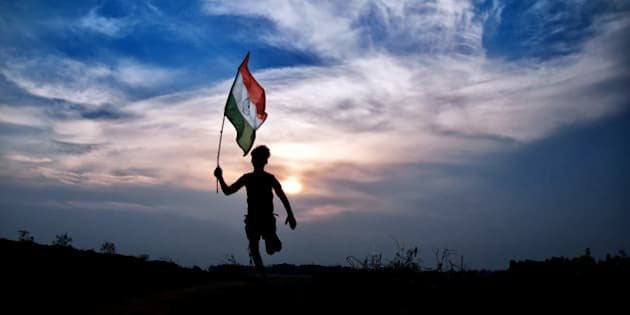 Boy running with indian flag