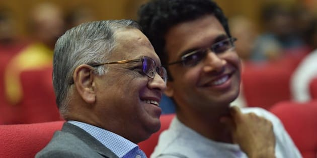 Infosys co-founder Narayana Murthy (L) and his son Rohan Murthy watch the proceedings during the company's 34th Annual General Meeting of the company in Bangalore on June 22, 2015. AFP PHOTO        (Photo credit should read STR/AFP/Getty Images)