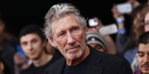 """Roger Waters attends the premiere of """"Roger Waters The Wall"""" at the Ziegfeld Theatre on Monday, Sept. 28, 2015, in New York. (Photo by Andy Kropa/Invision/AP)"""