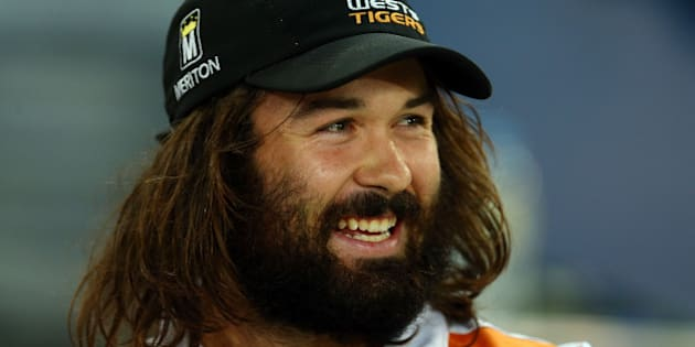 SYDNEY, AUSTRALIA - MARCH 27:  Injured Tigers player Aaron Woods watches from the sideline during the round four NRL match between the Wests Tigers and the Canterbury Bulldogs at ANZ Stadium on March 27, 2015 in Sydney, Australia.  (Photo by Renee McKay/Getty Images)